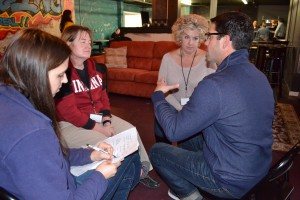 "Class members (from left) Kate Brown, Teresa Smith, Kimberly Sombke and Matt Davis discuss their group project at the end of Community Issues Day. The team will work to establish a ""sensory"" garden at J.B. Stephens Elementary School, where Davis is principal."