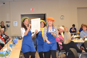Some class members offered some dramatic flair for their presentations. One group brought Fatheads. Team Mural, on the other hand, donned artist costumes to present their work on adding murals to buildings in Greenfield. Team members were (from left) Laurene Lonnemann, Cindi Holloway and Regina Jackson. The fourth team member, Dede Allender is not visible in this photo.
