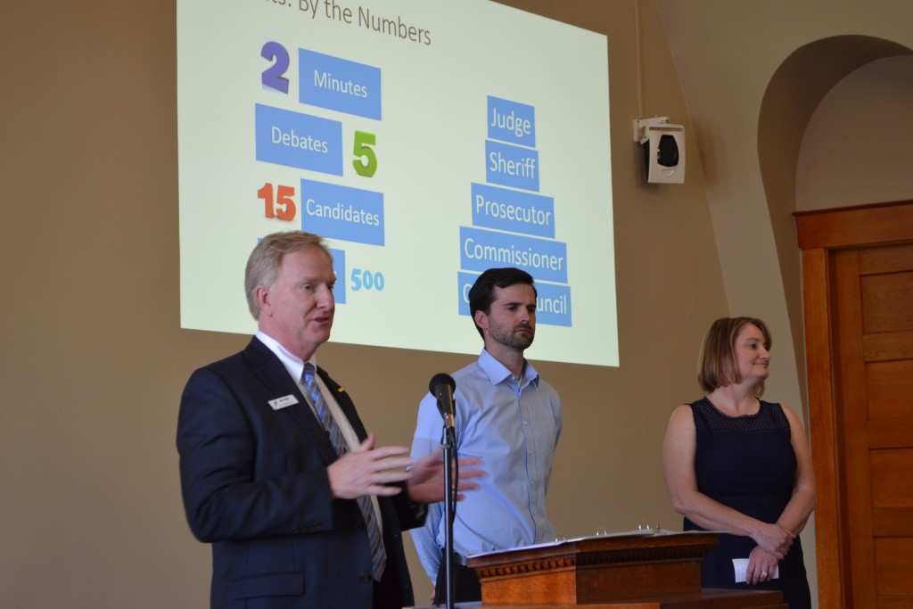 Greg Woods (left), Nick Riedman and Staci Starcher, members of the Class of 2018, present a summary of their community project during the class's graduation celebration. The three were part of Team Debate, which successfully put on five political debates last spring as part of its project to create county debate committee.