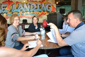 Jeff Rasche (right) makes a point to the rest of Team Dental during their first meeting to discuss the project. Nicole Mann (center), practice manager of the Jane Pauley Community Health Center, is sponsor of the project.